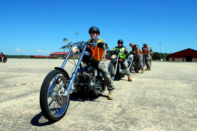 Chief Warrant Officer Josh Dellavecchia, B Co., 4/3 Avn. Regt. prepares to ride through a lane designed to train riders on how to manage turns during motorcycle safety training at Hunter Army Airfield, April 3.