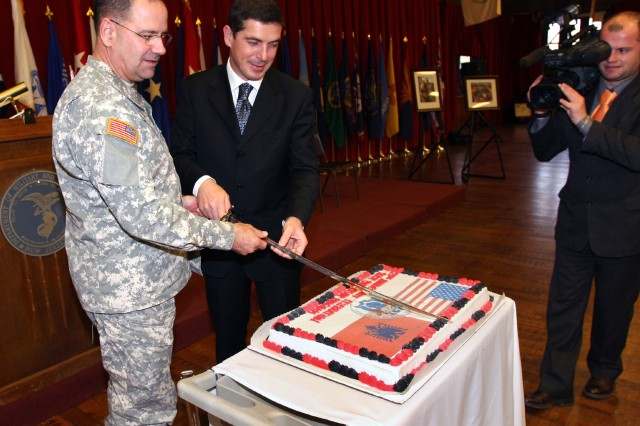 Maj. Gen. Glenn K. Rieth (left), the adjutant general of New Jersey and Gazmend Oketa (right), minister of defense for the republic of Albania, cut a special anniversary cake commemorating the 15-year partnership between New Jersey and the Republic of Albania in December. This month Albania achieved its long-standing goal of membership in the North Atlantic Treaty Organization.