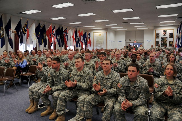 Personnel from the NCO Academy Warrior Leader Course listen to Command Sgt. Maj. Leon E. Caffie speak at their graduation ceremony. (Photo by Val Hyde)
