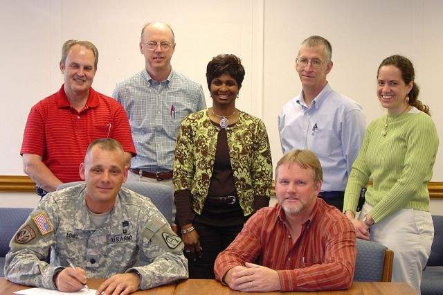 Seated are Lt. Col. Derek Long, left, Aviation Rockets product manager; and Mark Shackelford, GDATP Hydra program manager. Standing are Bill Wharton GDATP AUR IPT co-lead; Larry Ingram, GDATP Payload IPT co-lead; Daphne Henry, Propulsion IPT co-lead; Stacy Walbridge, GDATP Propulsion IPT co-lead; and Gina Gastler, AUR IPT co-lead.