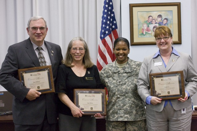 Col. Deborah B. Grays, second from right, U.S. Army Garrison commander, presents Freedom Team Salute commendations to (from left) Buck Hilliard, Lynn Roberts and Superintendent of Schools Kathy Cox.