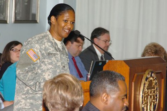 Col. Deborah B. Grays (in uniform), U.S. Army Garrison commander, addresses an audience at the Georgia Department of Labor April 2 at GaDOE headquarters before giving commendations to several members.