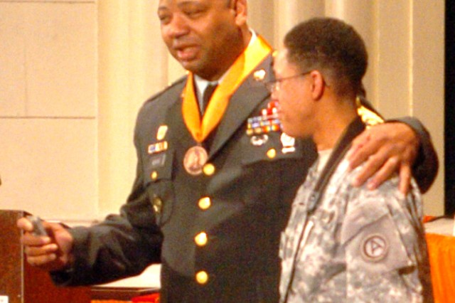 FORT MCPHERSON, Ga. -- Adkins gives his sergeant major rank to his Soldier, Sgt. Michelle Taylor, USARCENT G-6 Network Administrative NCO, during his retirement ceremony. Adkins reminded Taylor to always move toward success, as he did during his 30-year Army career.
