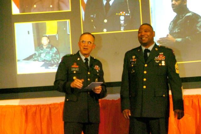 Lt. Gen. James J. Lovelace (left), U.S. Army Central commander, Speaks of Sgt. Major Arthur Adkins contribution to the U.S. Army during Adkins' retirment ceremony.