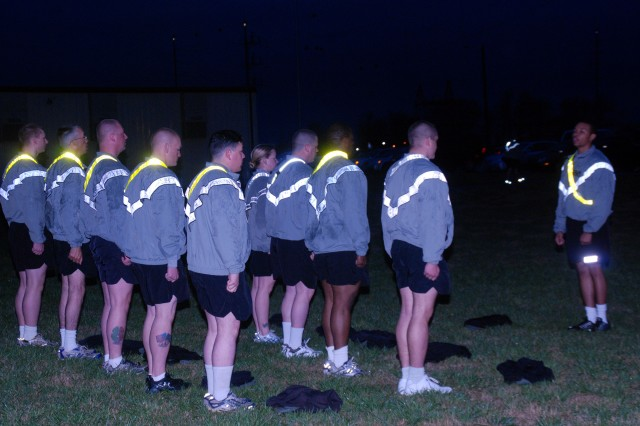 Sgt. Robert McGee of Headquarters Company,101st Combat Aviation Brigade prepares his group of Soldiers for an early morning run on Fort Campbell.