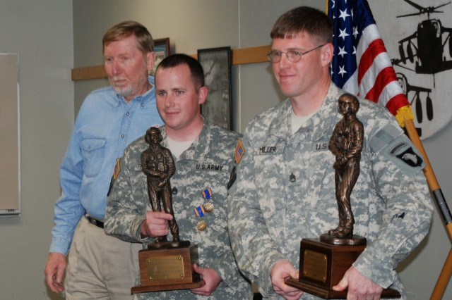 Dan Gower, representative for the Dustoff Association, poses with Staff Sgts. James Frailey (left) and Michael Miller during a ceremony on Fort Campbell. Gower honored the Soldiers by presenting them with the Dustoff Association's Crew Chief and Flight Medic of the Year awards.
