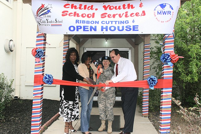 Brenda Berry, chief of Child, Youth and School Services; Dominique Edmonds, 10th grader; Col. Mary Garr, U.S. Army Garrison commander and Paul Matthews, director of Family and Morale, Welfare and Recreation cut the ribbon April 6 at the CYSS open house.