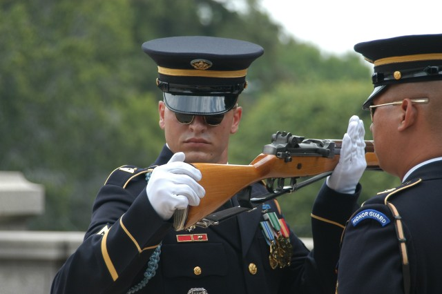 """Glory's Sentinels! This image shows an Honor Guard Inspection of the rifle of a memeber of """"The Old Guard,"""" the 3rd United States Infantry Regiment, being conducted at Arlington National Cemetery. (Image Courtesy of 3rd Regiment)."""