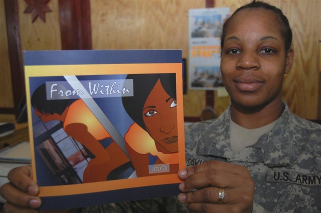"""Sgt. JoAnna Menzie Davis, noncommissioned officer in charge of awards for the 16th Sustainment Brigade, holds up a copy of her poetry book, """"From Within,"""" that was published while at Contingency Operating Base Q-West, Iraq. She received the first 20 copies of the glossy, 49-page book, March 20."""