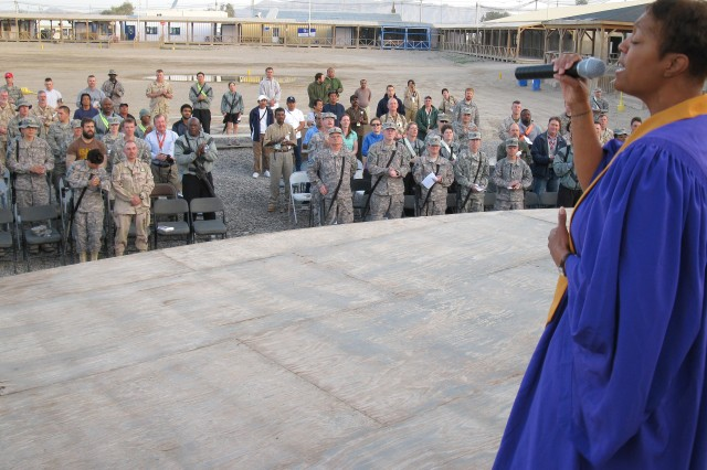 1st Lt. Lameka D. Grayson, a 143rd Expeditionary Sustainment Command support operations officer, sings on the KAF Boardwalk stage at an Easter sunrise service April 12.