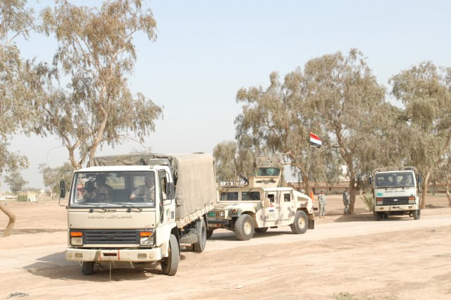 An Iraqi Army truck crew tows a simulated disabled vehicle during convoy operations training April 8, at Camp Taji, Iraq. The convoy operations event culminated two weeks of individual Soldier skills training led by the Iraq Army's 1st Battalion, 35th Brigade.