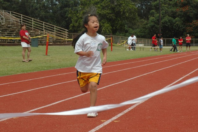 Faith Magno, 8, runs toward the finish line during the Track and Field Meet at Stoneman Stadium, April 4. More than 170 participants raced their way to ribbons and prizes during the event.