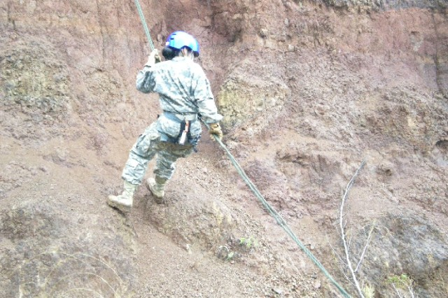 SCHOFIELD BARRACKS, Hawaii - A JROTC cadet rappels off the side of a cliff at the East Range during a Cadet Leadership Challenge, March 26-April 2, at Area X, Schofield Barracks.