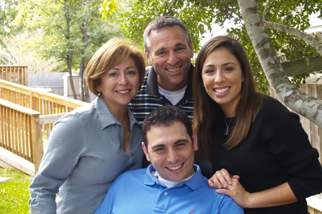 Cpl. (Ret.) Alan Babin, seated, poses with his family (clockwise) Al Sr., Christy, and Rosie Babin. Alan was severely injured in the early days of the war in Iraq.