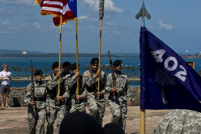 The 402nd Civil Affairs Battalion color guard marches on the battlements of the San Felipe de El Morro castle in the Old San Juan on April 4, for the unit's re-establishment ceremony. The U.S. Army Reserve unit is a part of the U.S. Army Civil Affairs and Psychological Operations Command (Airborne), headquartered at Fort Bragg, N.C.