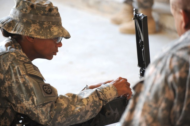 BAGHDAD - Staff Sgt. Tonisha Woods, of Fayetteville, N.C., assigned to the 3rd Brigade Combat Team, 82nd Airborne Division, Multi-National Division - Baghdad, performs a functions check on a .50 cal machine gun during the hands-on evaluation of the Sgt. Audie Murphy board April 11 at Joint Security Station Loyalty, located in eastern Baghdad. The board was a two-day event which test NCOs on a variety of military knowledge and warrior skills. Twelve NCOs were nominated for membership and will move on to the division level evaluation.