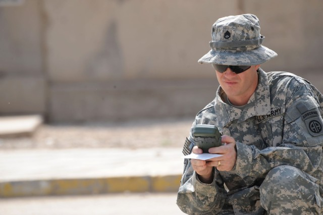 BAGHDAD - Staff Sgt. Ronnie Mason, of Sanford, N.C., assigned to the 1st Battalion, 319th Airborne Field Artillery Regiment, uses a navigation device during the land navigation portion of the Sgt. Audie Murphy board April 11 at Joint Security Station Loyalty, located in eastern Baghdad. The board was a two-day event which tests NCOs on a variety of military knowledge and warrior skills. Mason was one of 12 NCOs nominated for membership and will move on to the division level and be evaluated by the division's senior leaders.
