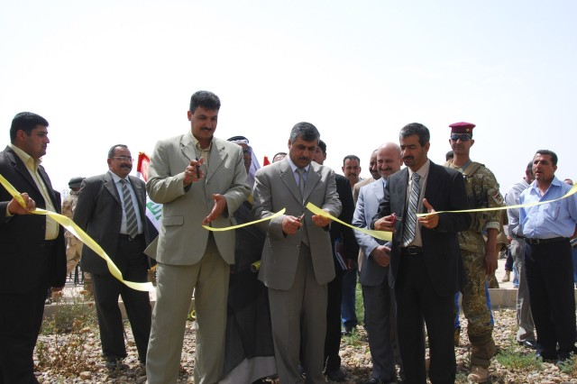 Iraqi Leaders from the Ministry of Electricity cut the ceremonial ribbon, April 8, to signify the opening of a new 33-volt feeder line providing power to the citizens of Agurquf in the Abu Ghraib district. The joint project will provide more reliable power with greater redundancy in reducing the chance of power failure from overloading to the people of Agurquf.