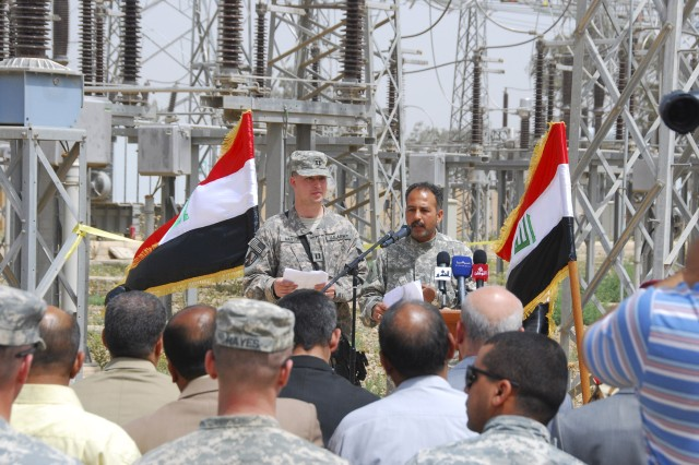 Capt. Jackie Manton, 225th Engineer Brigade, Multi-National Division - Baghdad, speaks to members of the crowd gathered to celebrate the opening of a new feeder line April 8, which provides power to the Agurquf area in the Abu Ghraib district. The project was completed through the efforts of Iraqi and Coalition Forces working together to improve the quality of life in the Abu Ghraib district.