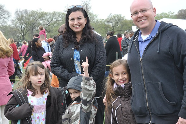 Sgt. 1st Class Jon P. Herrejon, 3-4th Air Defense Artillery at Fort Bragg, N.C., attends the White House Easter Egg Roll Monday with his wife Evonne, and his son and daughters.