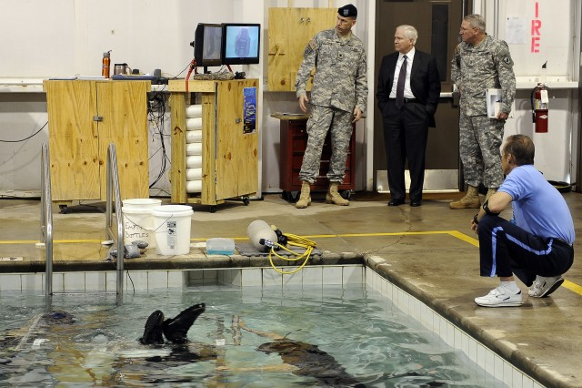 Defense Secretary Robert M. Gates receives a tour of the Helicopter Overwater Survival Training on Hanchey Army Airfield, Ala., April 14, 2009.