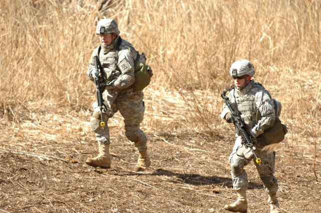 Staff Sergeant Michael Arthur (right) Company b, 1st Battalion, 64th Armor Regiment, 2nd Brigade Combat Team, 3rd Infantry Division, leads his squad during a training exercise in the Republic of Korea duringFoal Eagle. The battalion was in Korea for three and a half weeks taking part in the readiness exercise.
