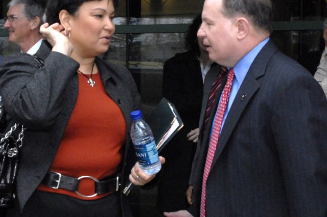 EPA Administrator Lisa Jackson meets Tad Davis, deputy assistant secretary of the Army for the environment, safety and occupational health. They met following a 10th birthday celebration for the EPA's Environmental Science Center at Fort Meade, Md., April 14.
