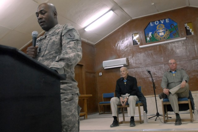 Command Sgt. Maj. Donald Battle, senior enlisted advisor for 2nd Heavy Brigade Combat Team, 1st Infantry Division, Multi-National Division - Baghdad, introduces Col. (retired) Robert Howard (center, in background) and Command Sgt. Maj. (retired) Gary Littrell (right, in background), who are both Medal of Honor recipients, at the Warrior Chapel on Camp Liberty, April 14. The two Vietnam War Veterans try to visit deployed Soldiers in Iraq and Afghanistan every April.