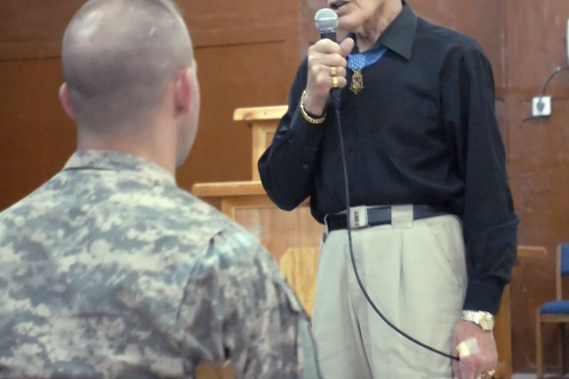 Col. (retired) Robert Howard, who earned the Medal of Honor while in combat in the Vietnam War, speaks to Soldiers serving with the 2nd Heavy Brigade Combat Team, 1st Infantry Division, Multi-National Division - Baghdad, at Warrior Chapel on Camp Liberty, April 14.