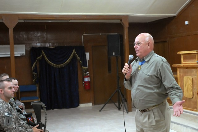 Command Sgt. Maj. (retired) Gary Littrell, who earned the Medal of Honor while in combat in the Vietnam War, speaks to Soldiers serving with the 2nd Heavy Brigade Combat Team, 1st Infantry Division, Multi-National Division - Baghdad, at Warrior Chapel on Camp Liberty, April 14. Littrell and Col. (retired) Robert Howard, who also earned the Medal of Honor in Vietnam, travel Iraq and Afghanistan to encourage Soldiers once a year.