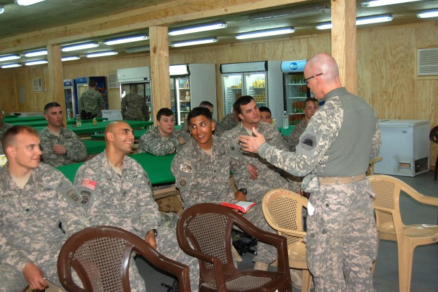 BAGHDAD - Chaplain (Capt) Timothy Meier, MND-B deputy operations chaplain, speaks with Soldiers of the 3rd Brigade Combat Team, 82nd Airborne Division at Joint Security Station Zafaraniyah as he conducts an Easter service April 12 for troops that may not have access to a fulltime chaplain. The paratroopers expressed their gratitude for the opportunity to take part in Easter communion as a duo of Division chaplains and their assistants convoyed out to four stations to reach Soldiers who were not on a large military complex.
