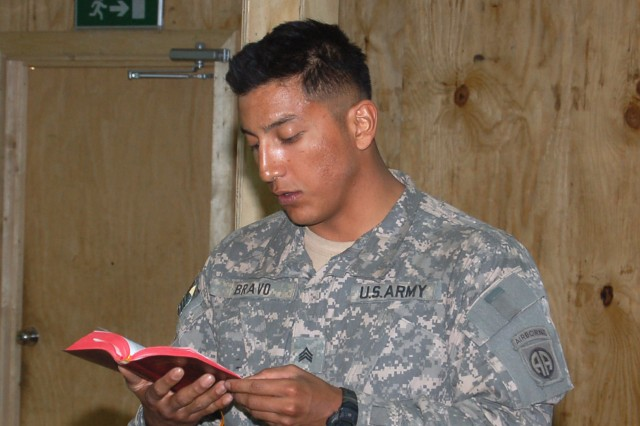 BAGHDAD - Sgt. Francisco Bravo, a Soldier with Battery A, 1st Battalion, 319th Field Artillery, reads a Bible passage as part of the Easter services conducted at Joint Security Station Zafaraniyah. MND-B chaplains convoyed to different JSS locations in an effort to provide Protestant and Catholic services and communion to Soldiers who may not have continued access to religious support.
