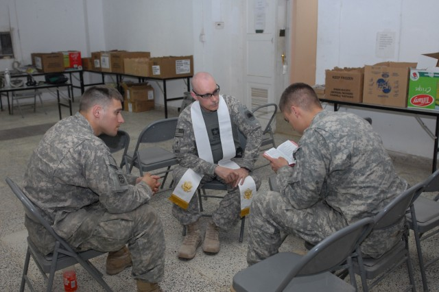 "BAGHDAD - Chaplain (Capt) Timothy Meier, MND-B deputy operations chaplain, engages two Soldiers of the Company B, 2nd Battalion, 505th Parachute Infantry Regiment assigned to Joint Security Station Hope on Easter Sunday. Regardless of the size of the audience, two MND-B chaplains, convoyed out to the stations where the paratroopers may otherwise not have had an Easter service at all. ""I'm grateful to have the opportunity to come out here,"" Chaplain Meier said. ""Besides the fact that I love Soldiers, for liturgical Christians, Easter is the most important holiday of the year."""
