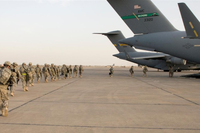 Soldiers of the 154th Transportation Company load onto a C-17 aircraft for their flight to Afghanistan at Baghdad International Airport, Iraq, April 14. The 154th Trans. Co., an active-component unit from Fort Hood, Texas, is the second 3rd Sustainment Command (Expeditionary) unit in three weeks to move directly to Afghanistan from Iraq.