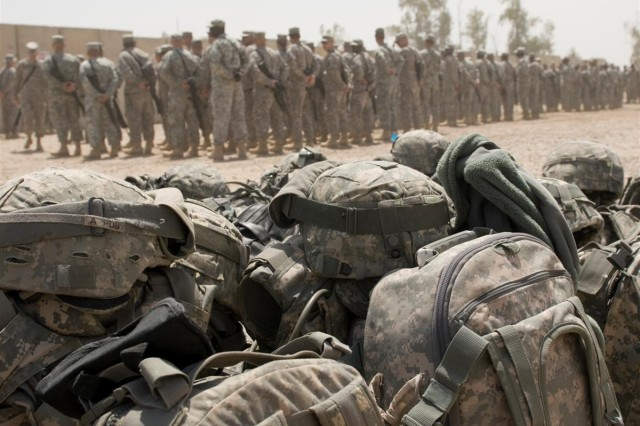 Soldiers of 154th Transportation Company from Fort Hood, Texas, stand in formation prior to leaving for Afghanistan at Baghdad International Airport, Iraq, April 14. The 154th Trans. Co. is the second 3rd Sustainment Command (Expeditionary) unit in three weeks to move directly to Afghanistan from Iraq.