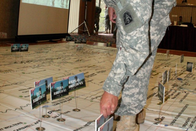 Capt. Jaime Calica of the U.S. Army North Directorate of Operations resets the terrain map during the Army's 2009 hurricane rehearsal of concept drill. The event, organized by U.S. Army North, attracts participants from military and civilian agencies involved in hurricane response.