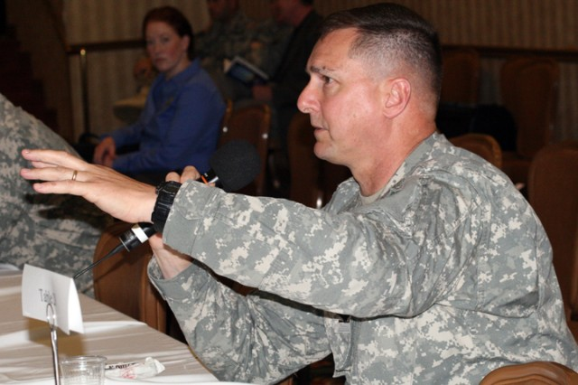 Col. Mark Armstrong, U.S. Army North's Region IX Defense Coordinating Officer, discusses the way ahead following the Army's 2009 hurricane rehearsal of concept drill.  The event, organized by U.S. Army North, attracts participants from state and federal agencies involved in hurricane response.