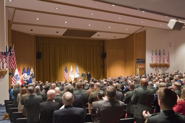 Army War College students stand and applaud after Secretary of Defense Robert Gates finished his talk at the Army War College April 16.