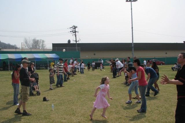 Children enjoy games in Soldier Field during the annual Easter Egg Hunt sponsored by the USAG-Casey Community Activity Center April 11.