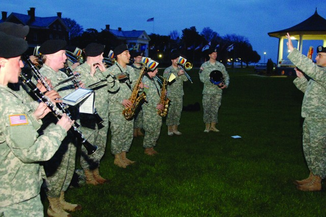 The U.S. Army Training and Doctrine Command Band performs motivational music during an early morning fun run that was part of an April 3 NCO Day observance at Fort Monroe, Va.
