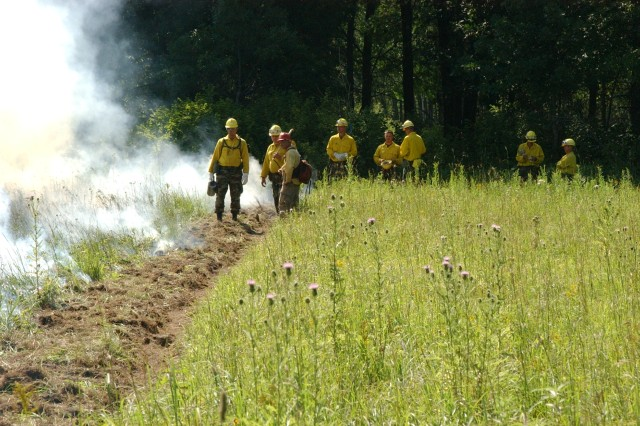 Staff from the Minnesota Department of Natural Resources and The Nature Conservancy help Camp Ripley workers conduct prescribed burns to combat wildland fires. Prescribed fires reduce fuel loads, enhance training, and sustain natural diversity on approximately 11,000 acres every year. Prescribed fire has also been effective at controlling and minimizing the spread of some invasive species.