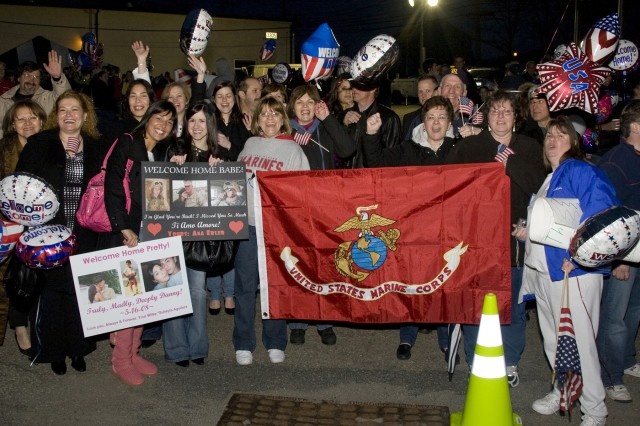 PICATINNY ARSENAL, N.J. - Friends and family members eagerly await the return of their Marines to Picatinny April 10.