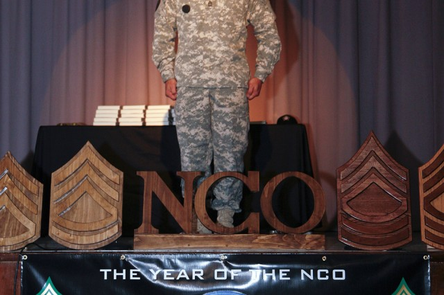 PICATINNY ARSENAL, N.J. - Sgt. 1st Class Alejandro Arroyo, Company A, 3rd Battalion, 385th Regiment, 98th Division, shouts the Drill Sergeant Creed before an audience of nearly 200 people at the NCO induction ceremony here April 4.
