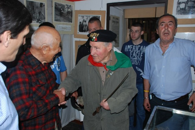 An Italian partisan shows Noel Okamoto and Camp Darby service members the actual bayonet he used when fighting against the Germans during World War II.