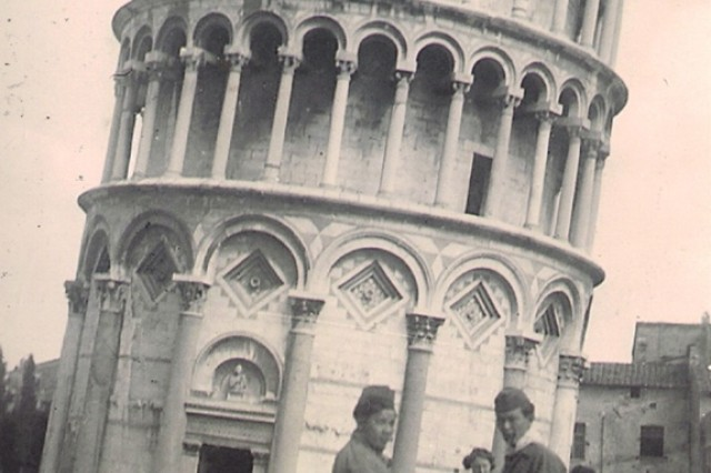 Pfc. Noel Okamoto visits the Leaning Tower of Pisa with friends from the 442nd Regimental Combat Team after World War II was finished. He returned to the site 64 years later and shared his experiences with young troops from Camp Darby.