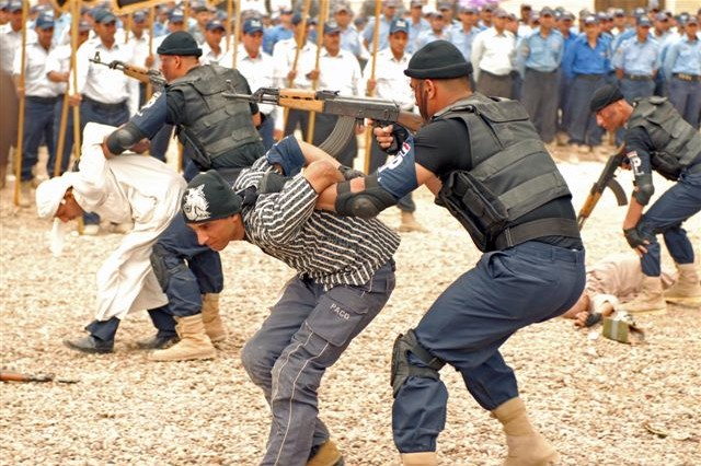 An Iraqi Police Special Operations team simulates terrorist assault and capture at Iraqi Police graduation ceremonies at Al Furat, Iraqi Police Training Center, Baghdad, April 15.