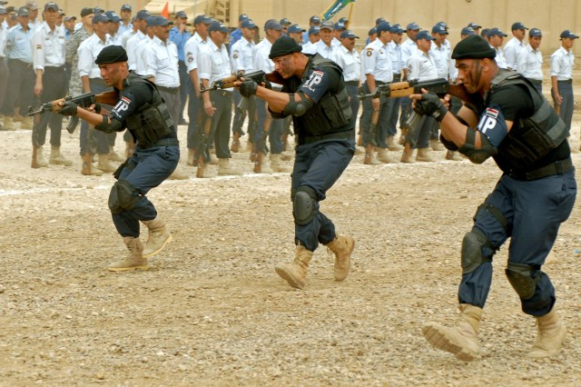 Terrorist assault and capture demonstrations were conducted by members of the Iraqi Police Special Operations team during the Iraqi Police graduation ceremonies at Al Furat Iraqi Police Training Center, Baghdad, April 15.