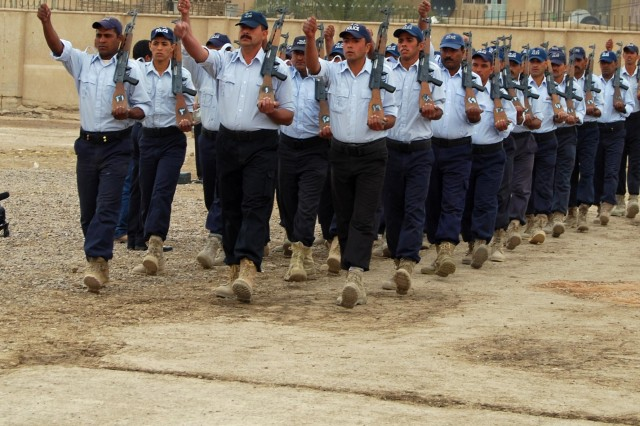 BAGHDAD- New Iraqi Police graduates march past the reviewing stand at Al Furat Training Center April 15.