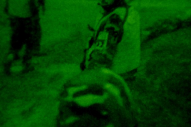 BAGHDAD - Iraqi Soldiers of the Commando Battalion, 17th Iraqi Army Brigade, move to a new position after an air-assault insertion in Owesat, during Operation Al Sakar April 12. The IA Soldiers with the assistance of Soldiers from 1st Battalion, 6th Infantry Regiment, 2nd Brigade Combat Team, 1st Armored Division, Multi-National Division-Baghdad, conducted a combined counter insurgency operation in search of insurgents, weapons and explosives caches.