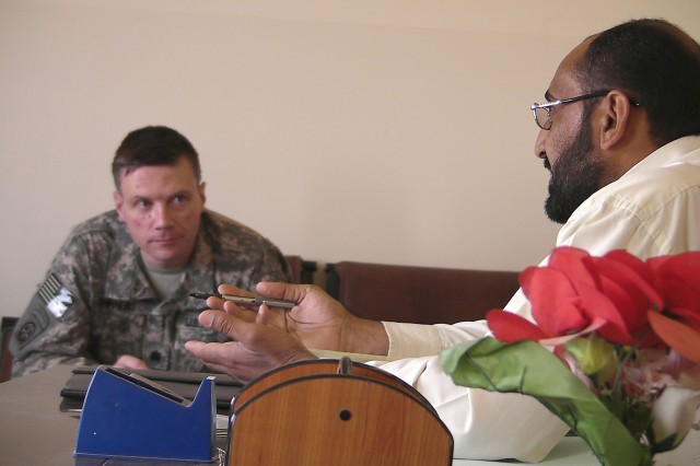 AL-MADAIN, Iraq - Sa'ad Salmin, the Al-Madain community sports chairman, talks with Lt. Col. Michael Shinners, of Alexandria, Va., during a site assessment mission April 18 in the Al-Madain area of eastern Baghdad. Shinners, the deputy commander of the 3rd Brigade Combat Team, 82nd Airborne Division, Multi-National Division - Baghdad, along with paratroopers visited several soccer fields in the region to prepare for an upcoming series of soccer clinics and tournaments that will be organized by FC Unity, a London-based organization that promotes the development of unity through soccer-based programs. Members of the FC Unity are scheduled to hold several soccer clinics across eastern Baghdad in mid-May.